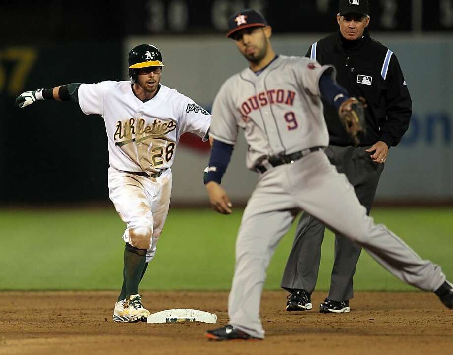 Oakland Athletics Eric Sogard safely reaches 2nd base on a double against the Houston Astros in the 5th inning of their MLB baseball game Tuesday, April 16, 2013 in Oakland, Calif. Photo: Lance Iversen, The Chronicle
