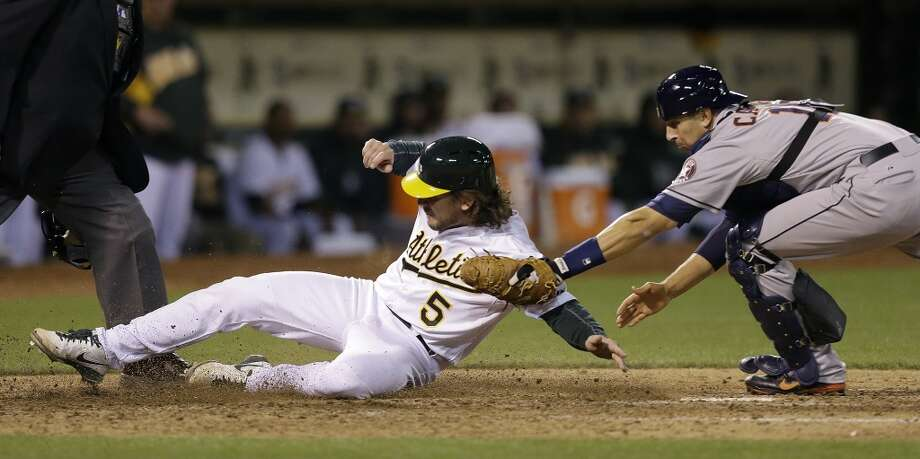 April 16: A's 4, Astros 3Astros catcher Jason Castro, right, tags out John Jaso (5) in the fifth inning. Photo: Ben Margot, Associated Press