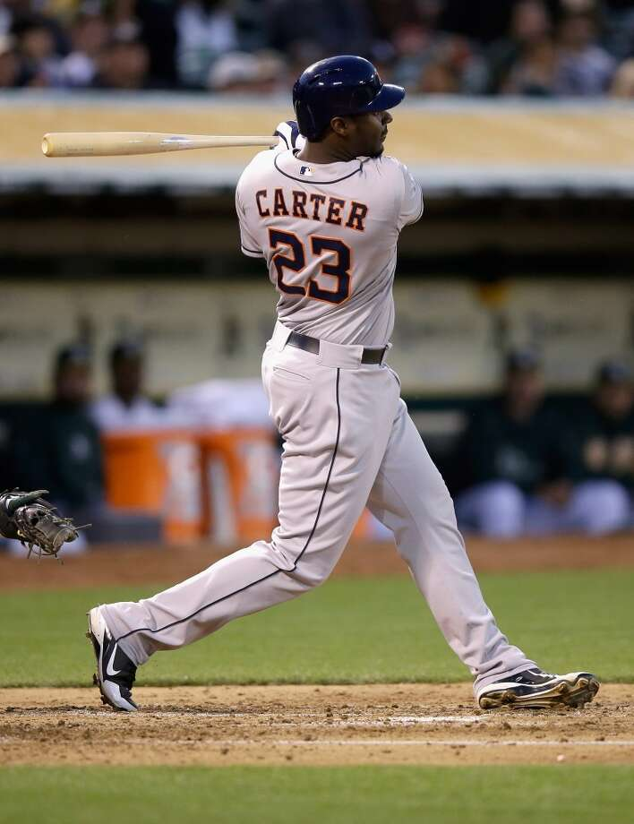 Chris Carter #23 of the Astros hits a single that scored Jose Altuve #27 in the third inning.