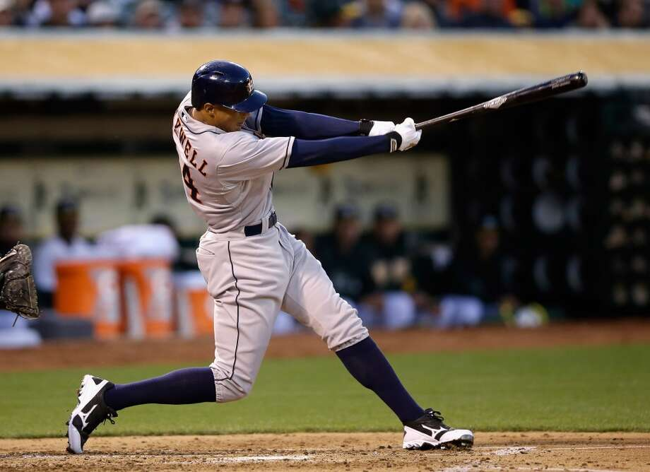 Justin Maxwell #44 hits a single that scored Marwin Gonzalez #9 in the third inning.