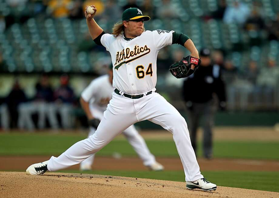 Oakland Athletics starting pitcher A.J. Griffin throws to the Houston Astros in the first inning of their MLB baseball game Tuesday, April 16, 2013 in Oakland, Calif. Photo: Lance Iversen, The Chronicle