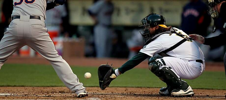 Oakland Athletics catcher John Jaso works the second inning against the Houston Astros Tuesday, April 16, 2013 in Oakland, Calif. Photo: Lance Iversen, The Chronicle
