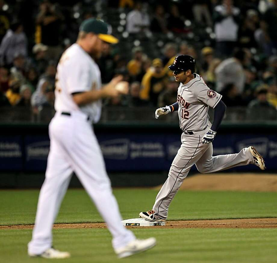 Carlos Pena of the Houston Astros rounds third base, after hitting a solo home run against Oakland Athletics pitcher Sean Doolittle, in the 8th inning of their MLB baseball game Tuesday, April 16, 2013 in Oakland, Calif. Photo: Lance Iversen, The Chronicle