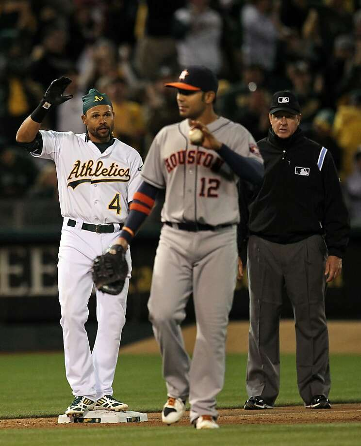 Oakland Athletics Coco Crisp celebrates after hitting a RBI triple against the Houston Astros in the 5th inning of their MLB baseball game Tuesday, April 16, 2013 in Oakland, Calif. Photo: Lance Iversen, The Chronicle
