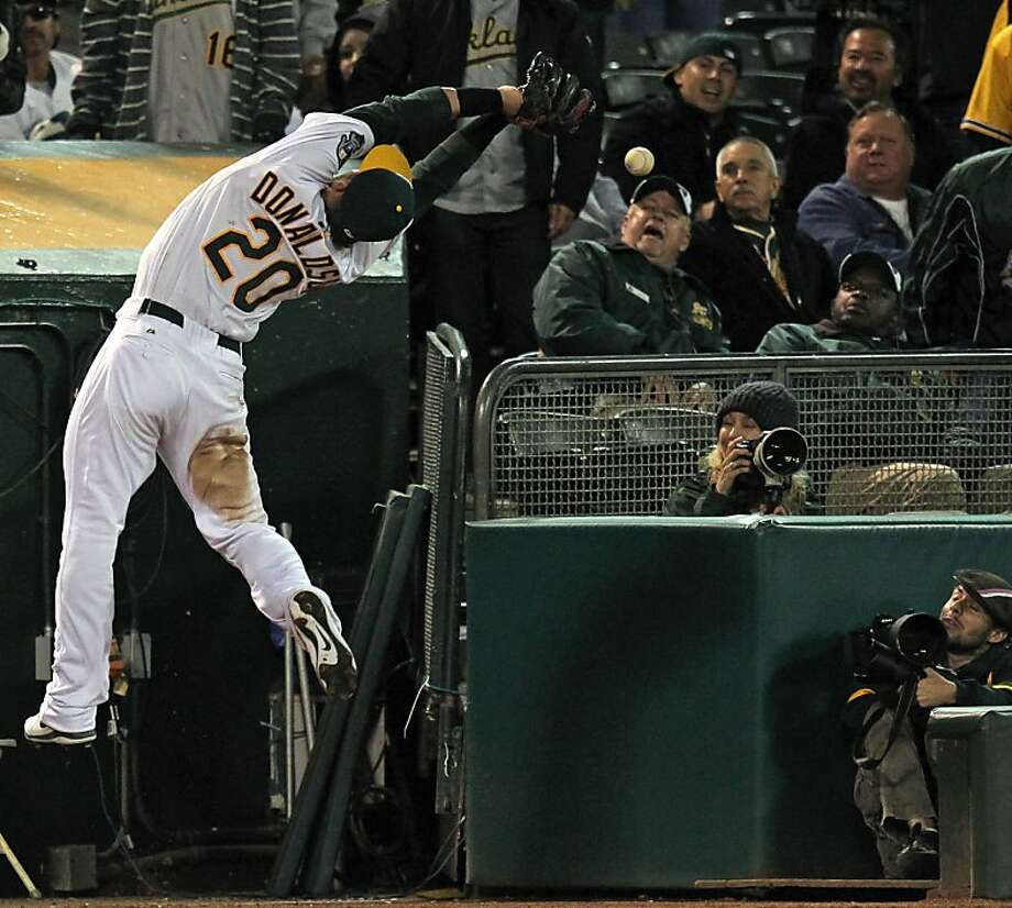 Oakland Athletics Josh Donaldson reaches for a foul ball by Houston Astros    Rick Ankiel in the 9th inning of their MLB baseball game Tuesday, April 16, 2013 in Oakland, Calif. Photo: Lance Iversen, The Chronicle