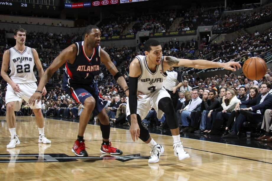 Spurs guard Danny Green (right0 loses a pass under pressure from the Atlanta Hawks\' Tracy McGrady during the first half at the AT&T Center, on Jan. 25, 2012. In back is Spurs forward Tiago Splitter.