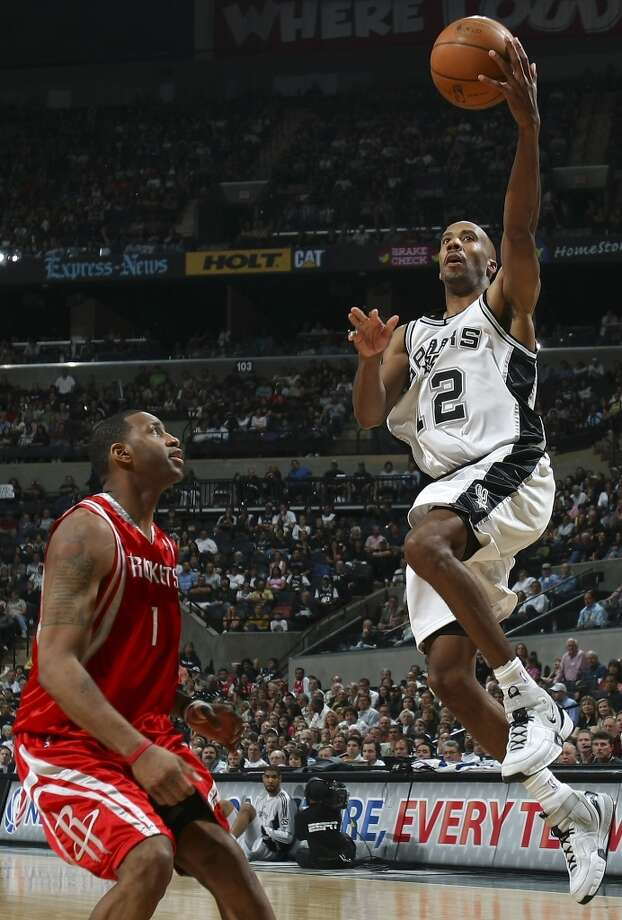 The Spurs\' Bruce Bowen shoots over the Houston Rockets\' Tracy McGrady during the second half on March 30, 2008, at the AT&T Center. The Spurs won 109-88.