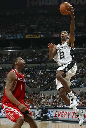 The Spurs\' Bruce Bowen shoots over the Houston Rockets\' Tracy McGrady during the second half on Ma