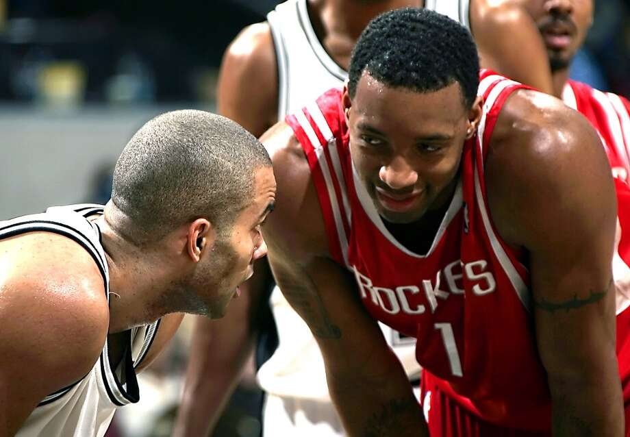 The Spurs\' Tony Parker (left) looks at the Houston Rockets\' Tracy McGrady before they go up for a jump ball in the second half on Jan. 24, 2007, at the AT&T Center.
