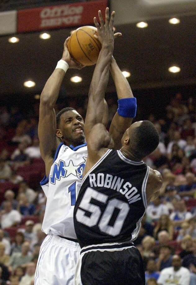 The Spurs\' David Robinson (50) blocks the shot of the Orlando Magic\'s Tracy McGrady (1) in the second quarter on Feb. 3, 2002, in Orlando, Fla.
