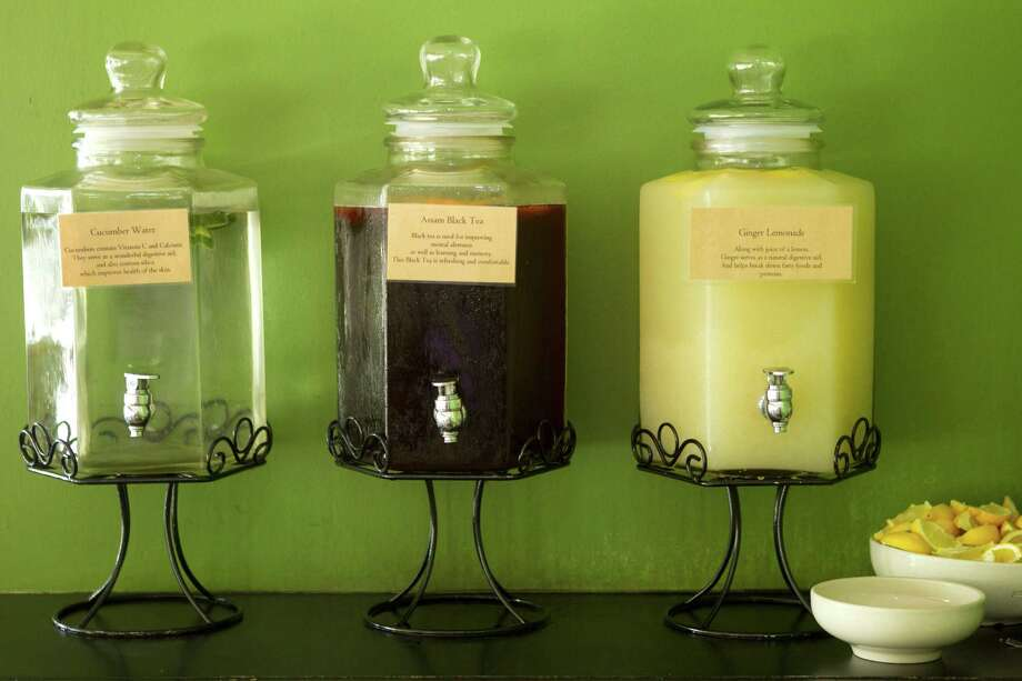 The beverage bar, with cucumber water, left, Assam black tea and ginger lemonade is shown at Paulie's Monday, April 8, 2013, in Houston. Photo: Brett Coomer, Houston Chronicle / © 2013 Houston Chronicle