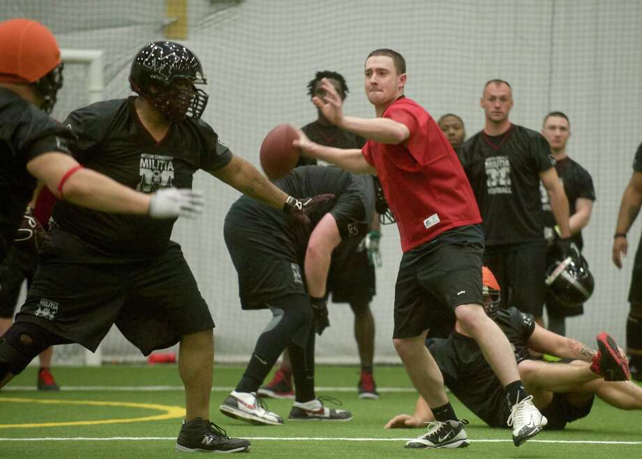 Quarterback Kevin Oberg looks to throw a pass during a scrimmage at the Western Connecticut Militia football team practice at Newtown Youth Academy on Tuesday April 16th, 2013. Photo: H John Voorhees III