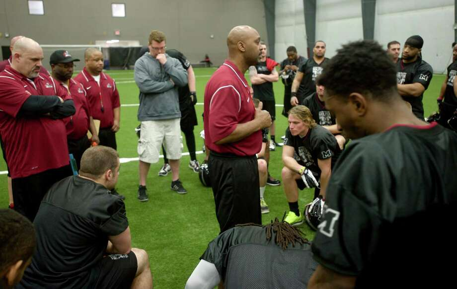 Western Connecticut Militia football team head coach Lonnie Young speaks to his team at the end of practice on Tuesday April 16th, 2013. Photo: H John Voorhees III