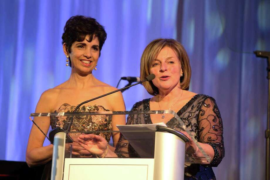 "Co-Founders and co-presidents of Lyme Research Alliance Diane Blanchard (left) and Debbie Siciliano, both of Greenwich, welcome guests to the recent ""Time for Lyme"" gala, which raised more than $1 million to fund research. Photo: Laura Landau/Contributed Photos"
