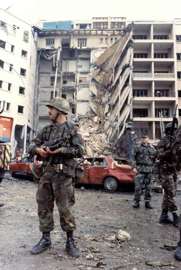 American Marines stand guard in front of the ruins of the American embassy, Beirut, 1983. The building was heavily damaged as a result of a suicide bombing on April 18, 1983, that killed more than 60 people and injured more than 100 more. Photo: PhotoQuest, Getty Images / Archive Photos