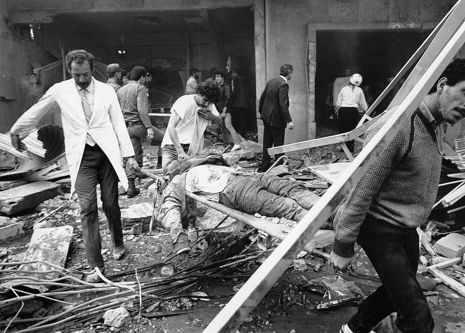 Rescue workers are shown carrying the body of a victim of the bomb blast at the American Embassy in Beirut, Lebanon, on April 18, 1983. The entire front of the seven-story building collapsed. Photo: JAMAL, ASSOCIATED PRESS / AP1983