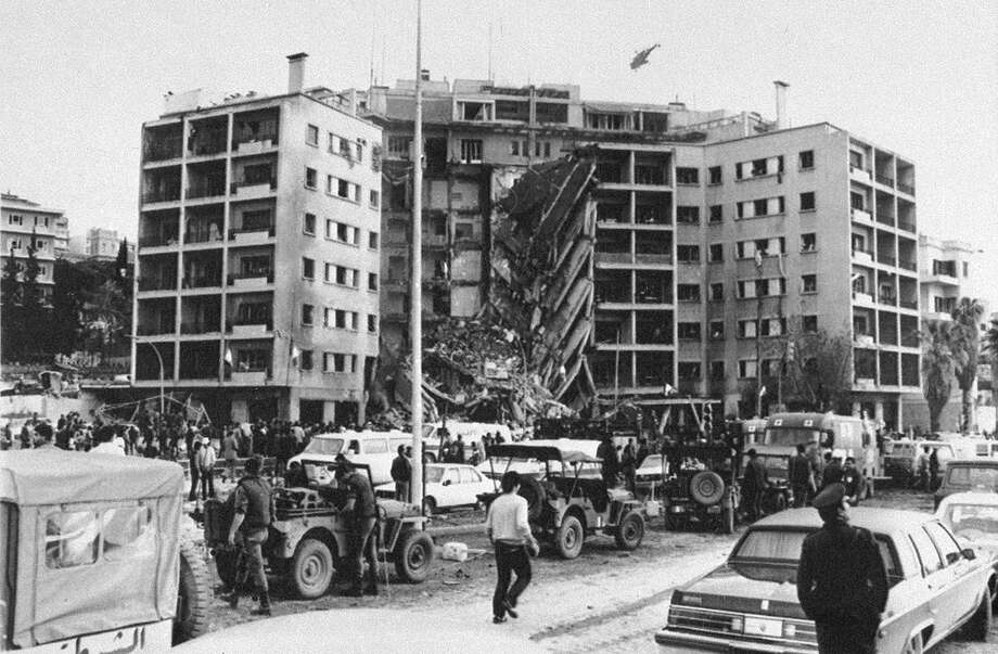 This is a general view of the American Embassy in Beirut, Lebanon, after a huge bomb blast caused the collapse of the entire front of the seven-story structure, April 18, 1983.  Rescue vehicles are seen in foreground as a helicopter flies overhead. Photo: Anonymous, ASSOCIATED PRESS / AP1983