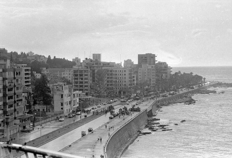 This is a general view of the American Embassy in West Beirut, seen April 18, 1983, which was damaged by a huge bomb blast Monday afternoon.  The bomb collapsed the entire front of the seven-story building.  Note Lebanese army vehicles have closed the road off. Photo: Eddie Tamerian, ASSOCIATED PRESS / AP1983