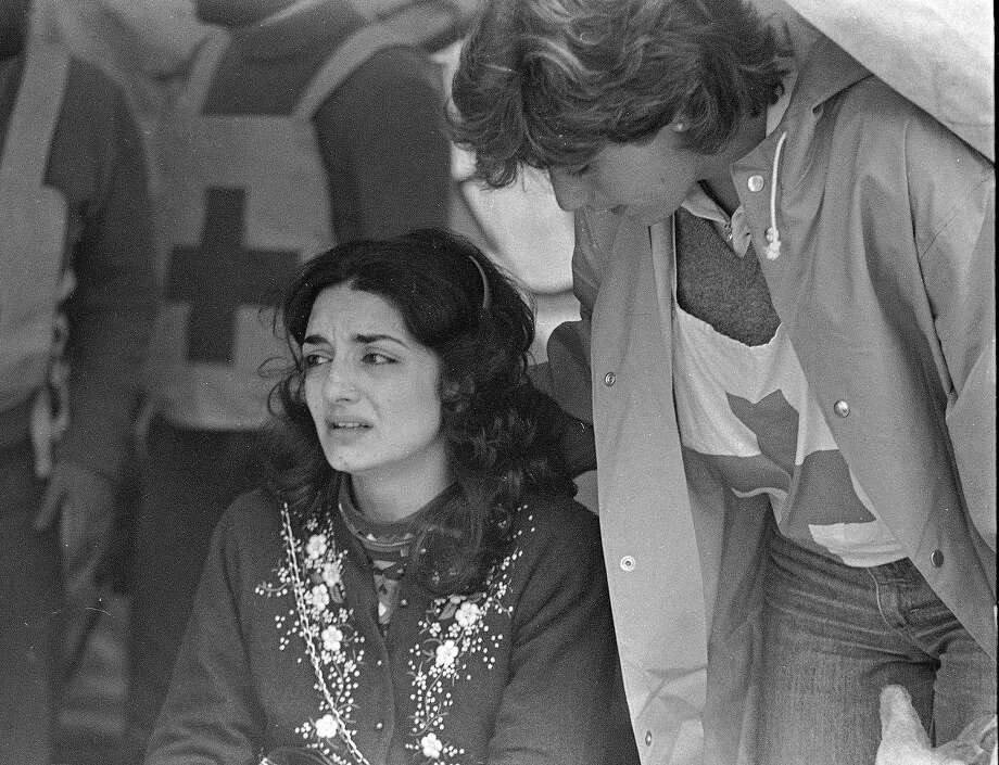 A Red Cross worker comforts Mrs. Seta Nahas as she sits in a Red Cross tent across the street from the rubble of the American Embassy, April 19, 1983.  Mrs. Nahas has been waiting for word about the fate of her husband, Kamal Nahas, 35, a Lebanese who worked in the Consular section of the Embassy.  Rescue workers continue to sift through the rubble. Photo: Bill Foley, ASSOCIATED PRESS / AP1983