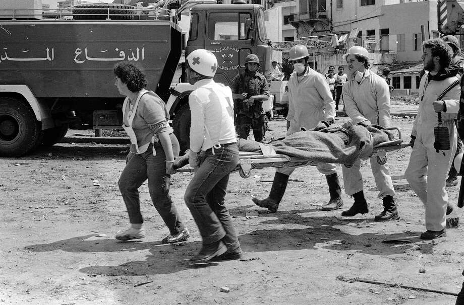 Rescue workers carry the body of one of the victims from the bomb blast at the American Embassy in Beirut, April 19, 1983.  The blast  caused extensive damage to the Embassy and killed 47 people while wounding 130. Photo: Paola Crociani, ASSOCIATED PRESS / AP1983