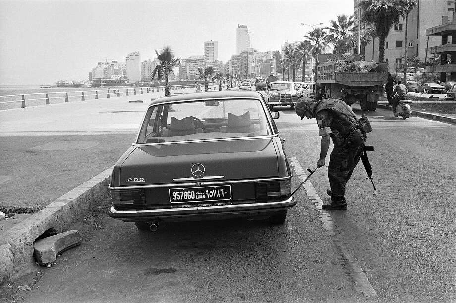 A U.S. Marine uses a mirror on a stick to check underneath a car in front of the building used as the U.S. Embassy in Beirut, Oct. 25, 1983.  Peacekeeping forces are tightening their security following a terrorist bombing of the U.S. Marine and French military installations on Sunday. Photo: Rawas, ASSOCIATED PRESS / AP1983