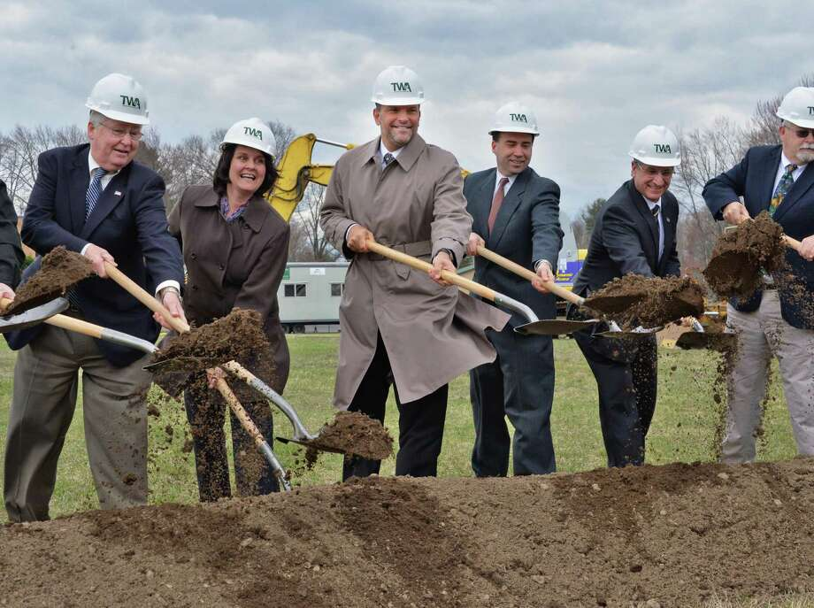 Bill Socha, center, is joined by dignitaries during the groundbreaking ceremony for his new $10M mixed-use building next to Socha Plaza on route 50 in Glenville, NY April 16, 2013.  (John Carl D'Annibale / Times Union) Photo: John Carl D'Annibale / 10021993A