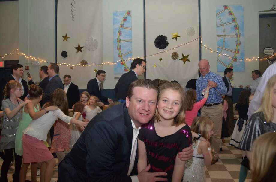 Nate Wilson and his daughter Gabriella take a turn on the dance floor during Hindley School's Tall & Small semiformal dance. Photo: Contributed
