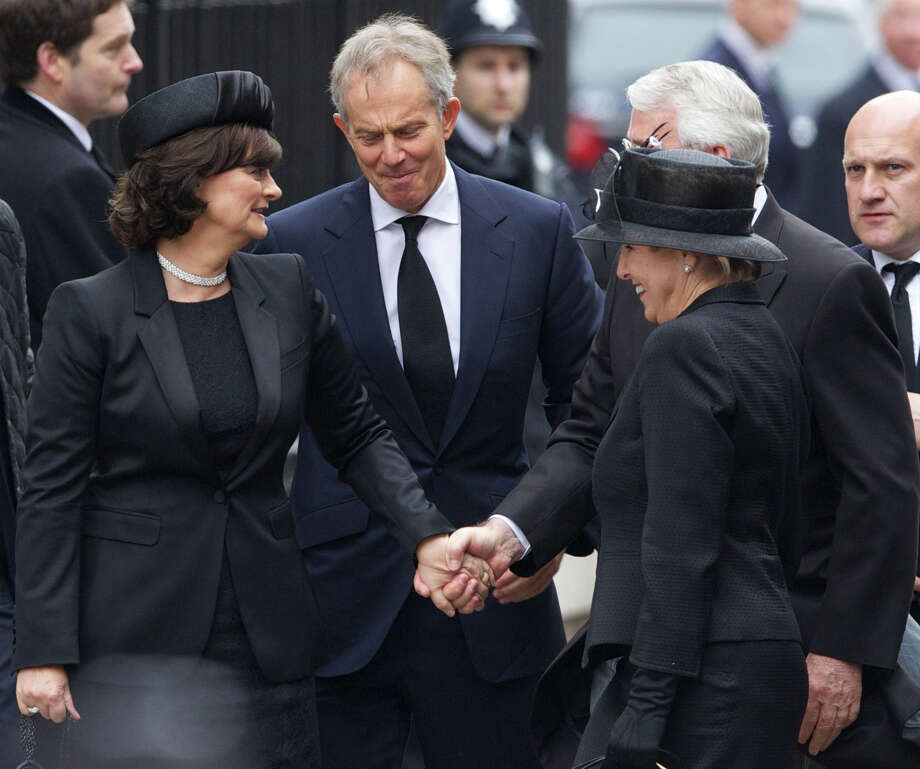 British former prime ministers John Major (2R) and Tony Blair (2L) and their wifes Norma Major (R) and Cherie Blair (L) arrive for the ceremonial funeral of British former prime minister Margaret Thatcher at St Paul's Cathedral in central London on April 17, 2013. The funeral of Margaret Thatcher took place on April 17, with Queen Elizabeth II leading mourners from around the world in bidding farewell to one of Britain's most influential and divisive prime ministers.  AFP PHOTO / ANDREW COWIEANDREW COWIE/AFP/Getty Images Photo: ANDREW COWIE, AFP/Getty Images / AFP