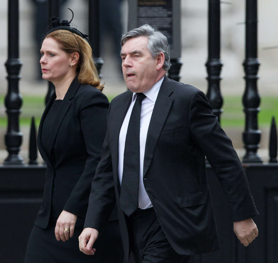British former prime minister Gordon Brown (R) and his wife Sarah (L) arrive for the ceremonial funeral of British former prime minister Margaret Thatcher at St Paul's Cathedral in central London on April 17, 2013. The funeral of Margaret Thatcher took place on April 17, with Queen Elizabeth II leading mourners from around the world in bidding farewell to one of Britain's most influential and divisive prime ministers.  AFP PHOTO / ANDREW COWIEANDREW COWIE/AFP/Getty Images Photo: ANDREW COWIE, AFP/Getty Images / AFP