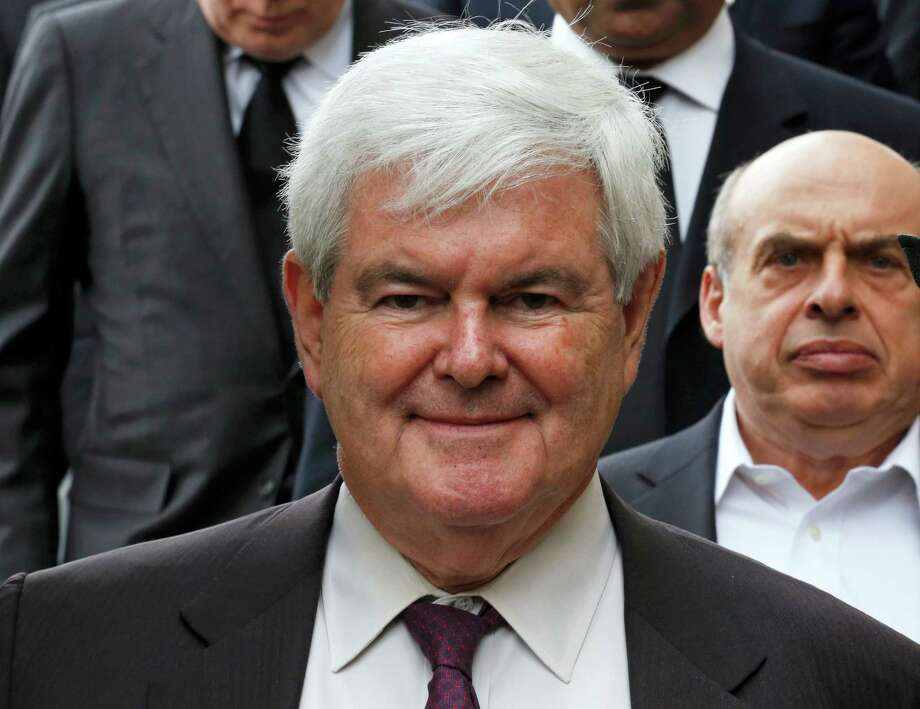 Former presidential candidate and former speaker of the US House of Representatives, Newt Gingrich leaves after attending the ceremonial funeral of British former prime minister Margaret Thatcher in St Paul's Cathedral in central London on April 17, 2013. The funeral of Margaret Thatcher took place on April 17, with Queen Elizabeth II leading mourners from around the world in bidding farewell to one of Britain's most influential and divisive prime ministers.  AFP PHOTO / POOL / OLIVIA HARRISOLIVIA HARRIS/AFP/Getty Images Photo: OLIVIA HARRIS, AFP/Getty Images / AFP