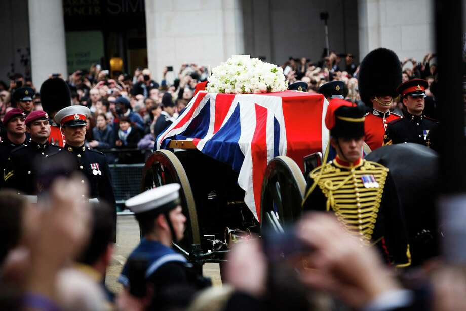 LONDON, UNITED KINGDOM - APRIL 17:  A Union flag draped coffin bearing the body of former British Prime Minister Margaret Thatcher is carried on a gun carriage drawn by the King's Troop Royal Artillery during her ceremonial funeral procession on April 17, 2013 in London, England. Dignitaries from around the world today join Queen Elizabeth II and Prince Philip, Duke of Edinburgh as the United Kingdom pays tribute to former Prime Minister Baroness Thatcher during a Ceremonial funeral with military honours at St Paul's Cathedral. Lady Thatcher, who died last week, was the first British female Prime Minister and served from 1979 to 1990. Photo: WPA Pool, Getty Images / 2013 Getty Images