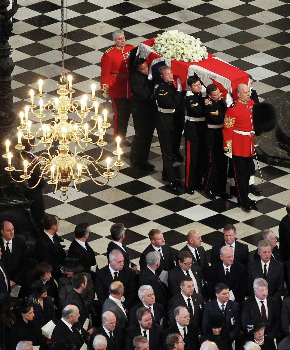 LONDON, UNITED KINGDOM - APRIL 17: The coffin bearing the body of Baroness Margaret Thatcher is carried into St Paul's Cathedral on April 17, 2013 in London, England. Dignitaries from around the world today join Queen Elizabeth II and Prince Philip, Duke of Edinburgh as the United Kingdom pays tribute to former Prime Minister Baroness Thatcher during a Ceremonial funeral with military honours at St Paul's Cathedral. Lady Thatcher, who died last week, was the first British female Prime Minister and served from 1979 to 1990.