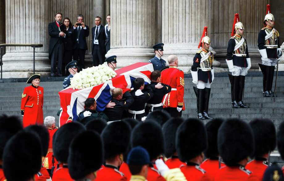 LONDON, UNITED KINGDOM - APRIL 17:  A Union flag draped coffin bearing the body of former British Prime Minister Margaret Thatcher is carried up the setsp of St Paul's Cathedral during her ceremonial funeral procession on April 17, 2013 in London, England. Dignitaries from around the world today join Queen Elizabeth II and Prince Philip, Duke of Edinburgh as the United Kingdom pays tribute to former Prime Minister Baroness Thatcher during a Ceremonial funeral with military honours at St Paul's Cathedral. Lady Thatcher, who died last week, was the first British female Prime Minister and served from 1979 to 1990. Photo: WPA Pool, Getty Images / 2013 Getty Images