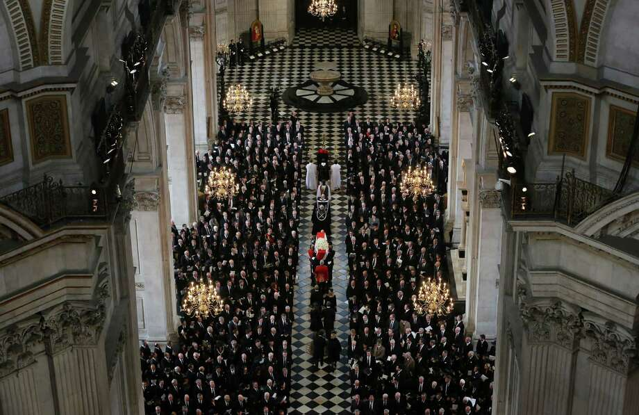 The Bearer Party made up of personnel from the three branches of the military carry the coffin of British former prime minister Margaret Thatcher during her ceremonial funeral in St Paul's Cathedral in central London on April 17, 2013. The funeral of Margaret Thatcher took place on April 17, with Queen Elizabeth II leading mourners from around the world in bidding farewell to one of Britain's most influential and divisive prime ministers.  AFP PHOTO / POOL / GARETH FULLERGARETH FULLER,GARETH FULLER/AFP/Getty Images Photo: AFP, AFP/Getty Images / AFP