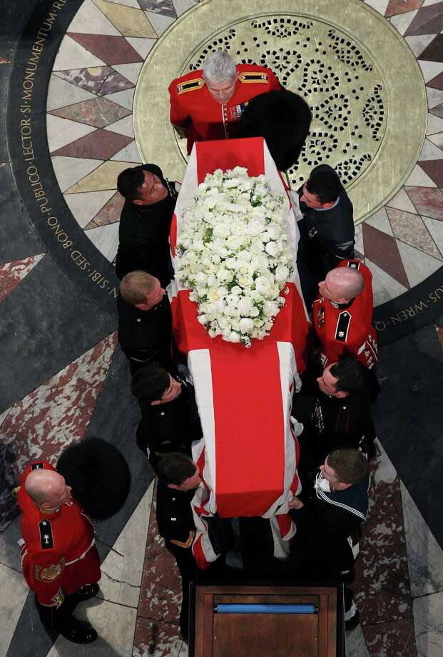 LONDON, UNITED KINGDOM - APRIL 17: The coffin bearing the body of Baroness Margaret Thatcher is carried into St Paul's Cathedral on April 17, 2013 in London, England. Dignitaries from around the world today join Queen Elizabeth II and Prince Philip, Duke of Edinburgh as the United Kingdom pays tribute to former Prime Minister Baroness Thatcher during a Ceremonial funeral with military honours at St Paul's Cathedral. Lady Thatcher, who died last week, was the first British female Prime Minister and served from 1979 to 1990. Photo: WPA Pool, Getty Images / 2013 Getty Images
