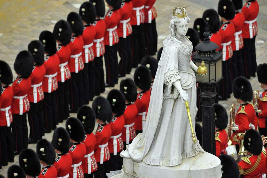 Guardsmen line up under the Statue of Queen Anne outside St Paul's Cathedral during the ceremonial funeral of British former prime minister Margaret Thatcher in central London on April 17, 2013. The funeral of Margaret Thatcher took place on April 17, with Queen Elizabeth II leading mourners from around the world in bidding farewell to one of Britain's most influential and divisive prime ministers.  AFP PHOTO / GLYN KIRKGLYN KIRK/AFP/Getty Images Photo: GLYN KIRK, AFP/Getty Images / AFP