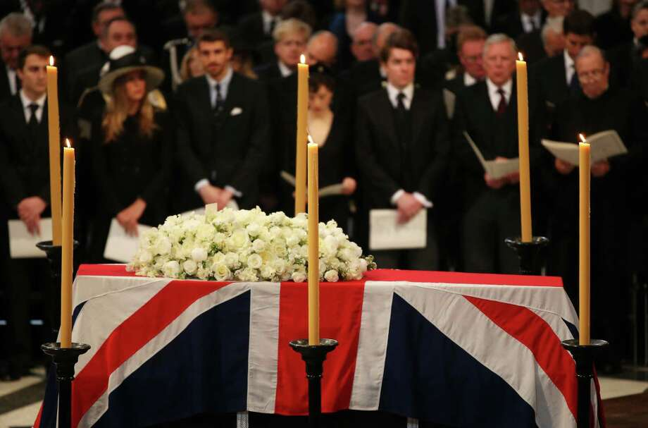 The coffin of British former prime minister Margaret Thatcher rests under the dome during her ceremonial funeral in St Paul's Cathedral in central London on April 17, 2013. The funeral of Margaret Thatcher took place on April 17, with Queen Elizabeth II leading mourners from around the world in bidding farewell to one of Britain's most influential and divisive prime ministers.  AFP PHOTO / POOL / CHRISTOPHER FURLONGChristopher Furlong/AFP/Getty Images Photo: CHRISTOPHER FURLONG, AFP/Getty Images / AFP
