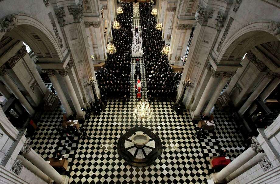The Bearer Party made up of personnel from the three branches of the military carry the coffin of British former prime minister Margaret Thatcher during her ceremonial funeral in St Paul's Cathedral in central London on April 17, 2013. The funeral of Margaret Thatcher took place on April 17, with Queen Elizabeth II leading mourners from around the world in bidding farewell to one of Britain's most influential and divisive prime ministers.  AFP PHOTO / POOL / STEFAN WERMUTHSTEFAN WERMUTH/AFP/Getty Images Photo: STEFAN WERMUTH, AFP/Getty Images / AFP