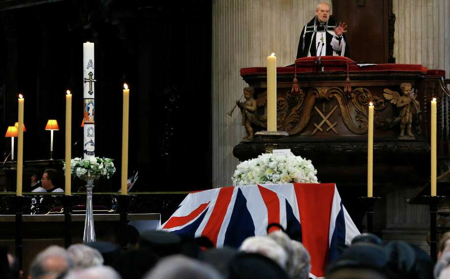Bishop of London Richard Chartres delivers an address from behind the coffin of British former prime minister Margaret Thatcher during her ceremonial funeral in St Paul's Cathedral in central London on April 17, 2013. The funeral of Margaret Thatcher took place on April 17, with Queen Elizabeth II leading mourners from around the world in bidding farewell to one of Britain's most influential and divisive prime ministers.  AFP PHOTO / POOL / KIRSTY WIGGLESWORTHKIRSTY WIGGLESWORTH/AFP/Getty Images Photo: KIRSTY WIGGLESWORTH, AFP/Getty Images / AFP