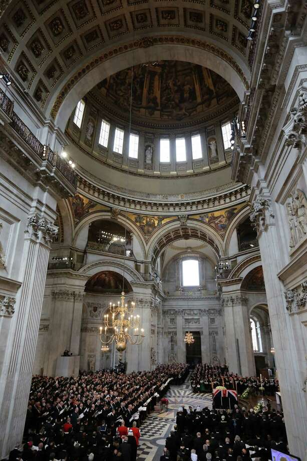 EDITORS NOTE: Image was created using a variable planed lens A general view shows the coffin of British former prime minister Margaret Thatcher and the mourners during her ceremonial funeral in St Paul's Cathedral in central London on April 17, 2013. The funeral of Margaret Thatcher took place on April 17, with Queen Elizabeth II leading mourners from around the world in bidding farewell to one of Britain's most influential and divisive prime ministers.  AFP PHOTO / POOL / CHRISTOPHER FURLONGChristopher Furlong/AFP/Getty Images Photo: CHRISTOPHER FURLONG, AFP/Getty Images / AFP
