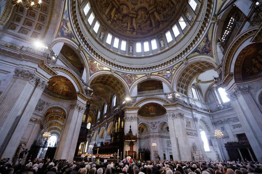The coffin of British former prime minister Margaret Thatcher and mourners sit under the dome during her ceremonial funeral in St Paul's Cathedral in central London on April 17, 2013. The funeral of Margaret Thatcher took place on April 17, with Queen Elizabeth II leading mourners from around the world in bidding farewell to one of Britain's most influential and divisive prime ministers.  AFP PHOTO / POOL / KIRSTY WIGGLESWORTHKIRSTY WIGGLESWORTH/AFP/Getty Images Photo: KIRSTY WIGGLESWORTH, AFP/Getty Images / AFP