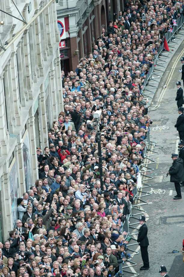 The crowd watches as the coffin bearing the body of former Prime Minister Margaret Thatcher makes it way to St Paul's Cathedral, central London for her funeral service Wednesday April 17, 2013. Margaret Thatcher was laid to rest Wednesday with prayers and ceremony, plus cheers and occasional jeers, as Britain paused to remember a leader who transformed the country _ for the better according to many, but in some eyes for the worse. Photo: David Crump/Daily Mail, AP / Pool Daily Mail