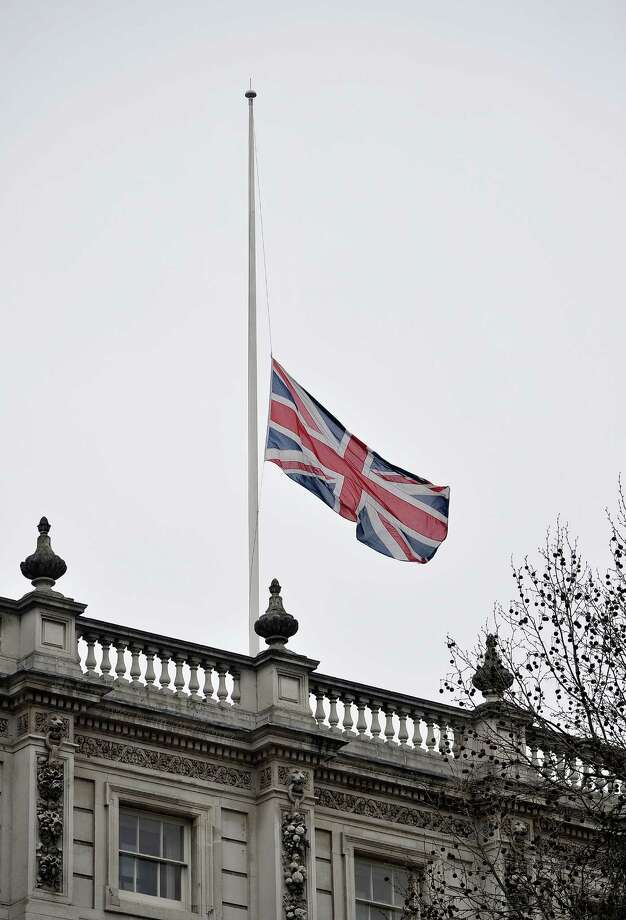 LONDON, ENGLAND - APRIL 17:  A flag fly's at half mast during the Ceremonial funeral of former British Prime Minister Baroness Thatcher on April 17, 2013 in London, England. Dignitaries from around the world today join Queen Elizabeth II and Prince Philip, Duke of Edinburgh as the United Kingdom pays tribute to former Prime Minister Baroness Thatcher during a Ceremonial funeral with military honours at St Paul's Cathedral. Lady Thatcher, who died last week, was the first British female Prime Minister and served from 1979 to 1990. Photo: Gareth Cattermole, Getty Images / 2013 Getty Images