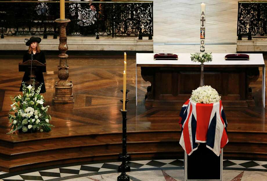 Amanda Thatcher, granddaughter of British former prime minister Margaret Thatcher gives a reading as her coffin sits draped in a Union Flag on the plinth during her ceremonial funeral in St Paul's Cathedral in central London on April 17, 2013. The funeral of Margaret Thatcher took place on April 17, with Queen Elizabeth II leading mourners from around the world in bidding farewell to one of Britain's most influential and divisive prime ministers.  AFP PHOTO / POOL / STEFAN WERMUTHSTEFAN WERMUTH/AFP/Getty Images Photo: STEFAN WERMUTH, AFP/Getty Images / AFP