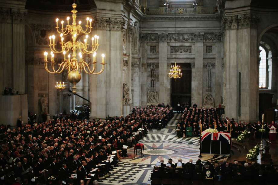 The coffin of British former prime minister Margaret Thatcher sits draped in a Union Flag during her ceremonial funeral in St Paul's Cathedral in central London on April 17, 2013. The funeral of Margaret Thatcher took place on April 17, with Queen Elizabeth II leading mourners from around the world in bidding farewell to one of Britain's most influential and divisive prime ministers.  AFP PHOTO / POOL / CHRISTOPHER FURLONGChristopher Furlong,Christopher Furlong/AFP/Getty Images Photo: AFP, AFP/Getty Images / AFP