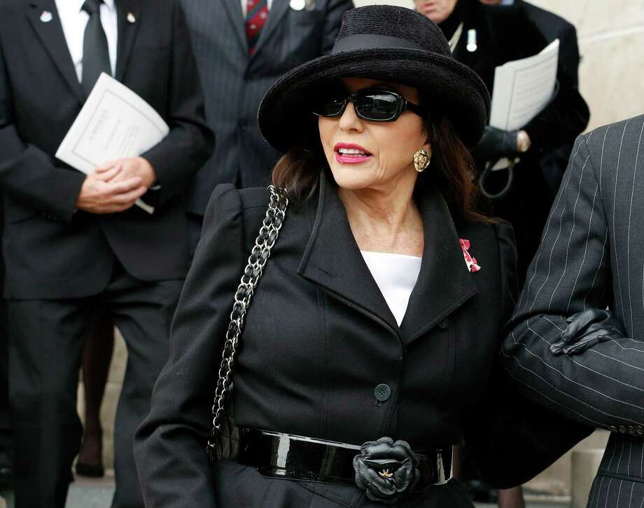 LONDON, UNITED KINGDOM - APRIL 17: Actress Joan Collins leaves after attending the funeral service of former British prime minister Margaret Thatcher at St Paul's Cathedral on April 17, 2013 in London, England. Dignitaries from around the world today join Queen Elizabeth II and Prince Philip, Duke of Edinburgh as the United Kingdom pays tribute to former Prime Minister Baroness Thatcher during a Ceremonial funeral with military honours at St Paul's Cathedral. Lady Thatcher, who died last week, was the first British female Prime Minister and served from 1979 to 1990. Photo: WPA Pool, Getty Images / 2013 Getty Images