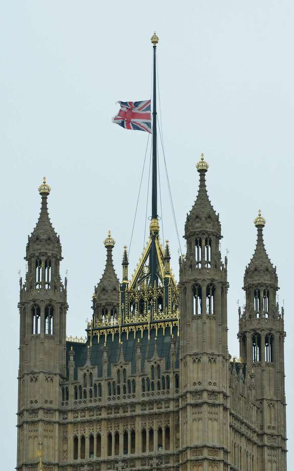 Britain's Union flag  flies at half-mast on top of Victoria Tower at the Houses of Parliament in central London on April 17, 2013 on the day of the ceremonial funeral of British former prime minister Margaret Thatcher. The funeral of Margaret Thatcher took place on April 17, with Queen Elizabeth II leading mourners from around the world in bidding farewell to one of Britain's most influential and divisive prime ministers.  AFP PHOTO / MIGUEL MEDINAMIGUEL MEDINA/AFP/Getty Images Photo: MIGUEL MEDINA, AFP/Getty Images / AFP