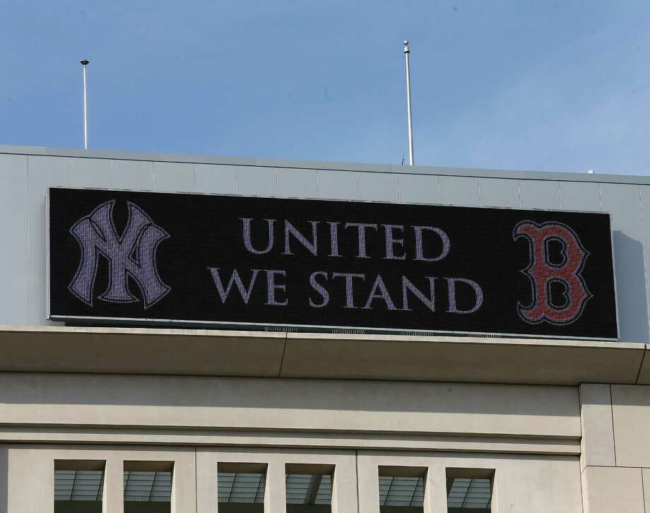 NEW YORK, NY - APRIL 16:  The outside of Yankee Stadium supports the victims of the bombings at the Boston Marathon before the game between the Arizona Diamondbacks the New York Yankees on April 16, 2013 at Yankee Stadium in the Bronx borough of New York City. In light of the bombings at the Boston Marathon on Monday, New York City has increased security. Photo: Elsa, Getty Images / 2013 Getty Images