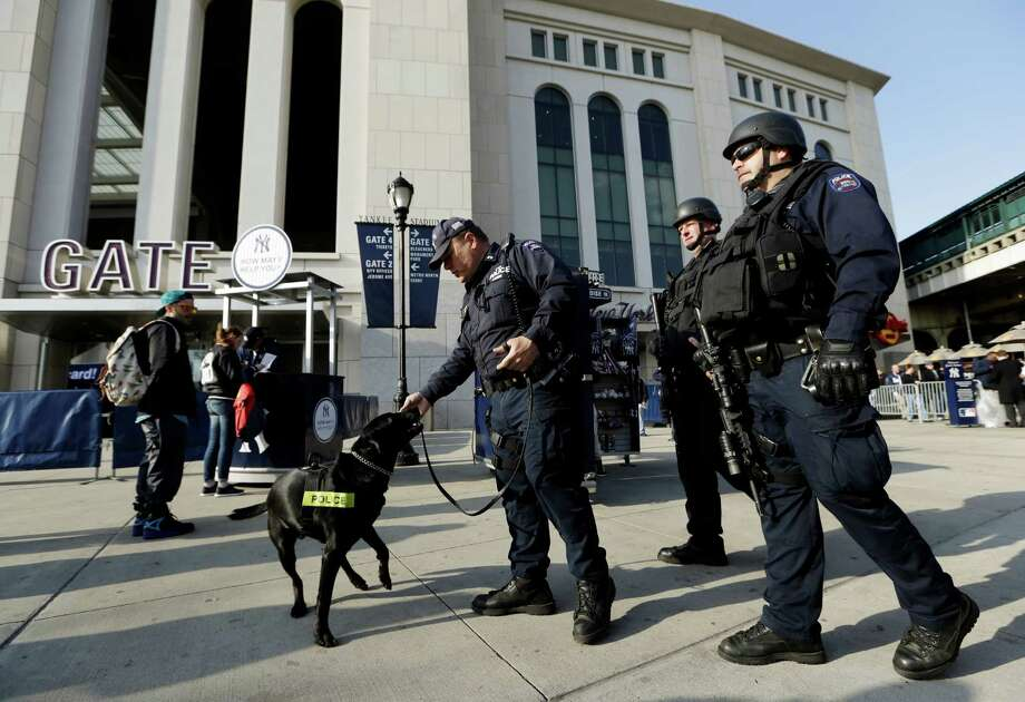 Police officers patrol in front of Yankee Stadium before a baseball game between the New York Yankees and Arizona Diamondbacks in New York, Tuesday, April 16, 2013. Signs of increased security were visible in the wake of the Boston Marathon explosions. Photo: Kathy Willens, AP / AP