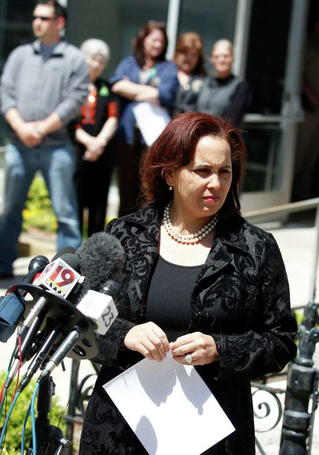 Judge Erleigh Wiley,  who was appointed the new district attorney of Kaufman County, talks during a press conference outside the Kaufman County Courthouse Thursday, April 11, 2013 in Kaufman, Texas. Gov. Rick Perry appointed Kaufman County Court-at-Law Judge Erleigh Norville Wiley to complete the term of slain District Attorney Mike McLelland.  (AP Photo/The Dallas Morning News, Michael Ainsworth)  MANDATORY CREDIT; MAGS OUT; TV OUT; INTERNET USE BY AP MEMBERS ONLY; NO SALES Photo: Michael Ainsworth, Associated Press / The Dallas Morning News